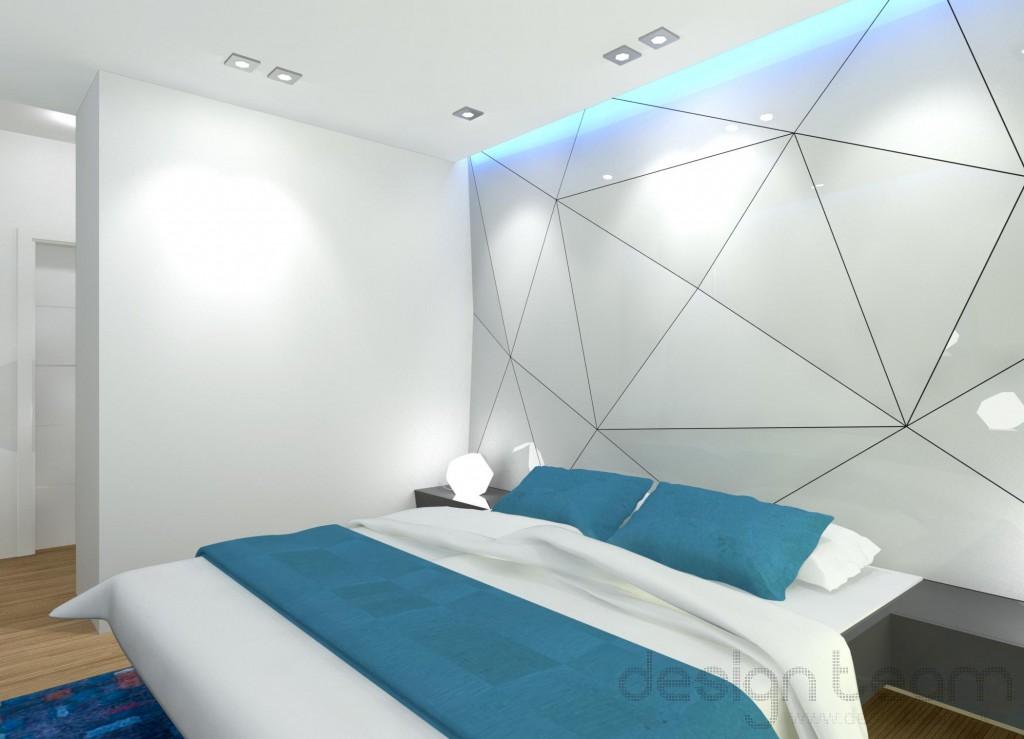 Stenu za posteľou sme obložili 3D obkladom z drevotriesky. Zaujímavý 3d tvar zvýrazní bodové osvetlenie.