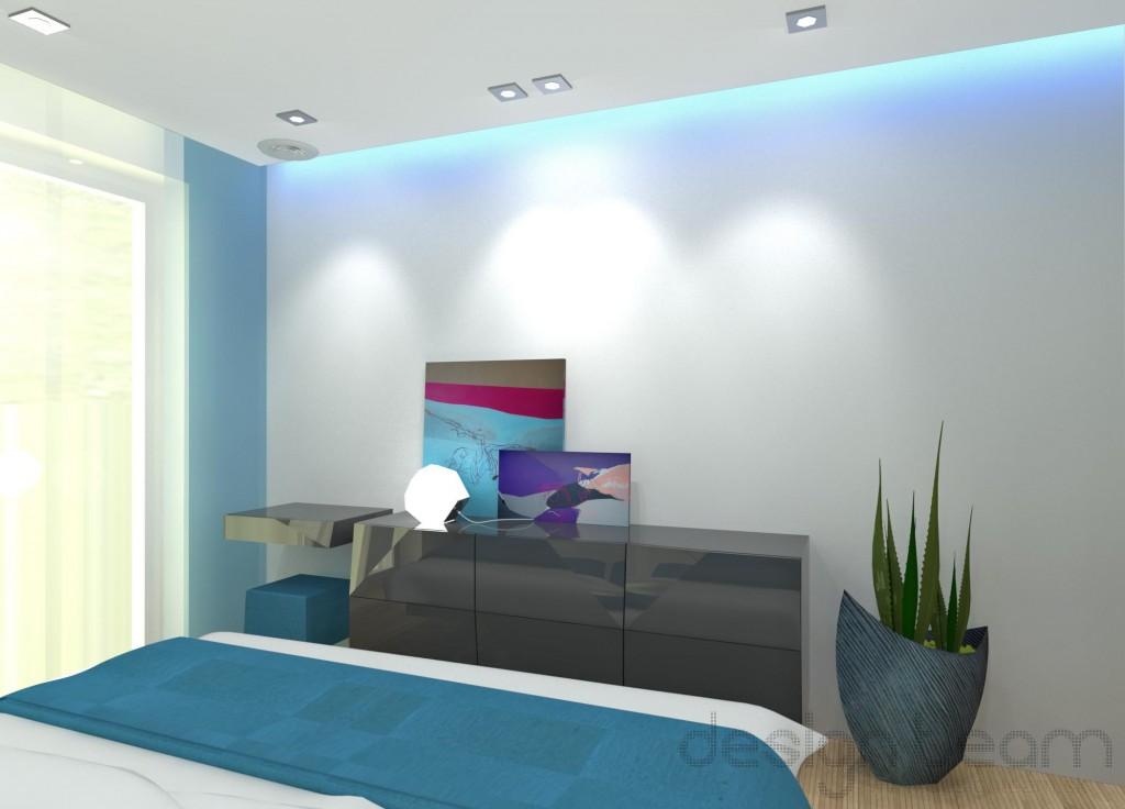 Komoda svojim tvarom nadväzuje na 3d stenu za posteľou.